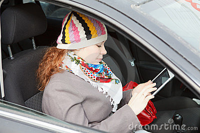 Woman with electronic device in car