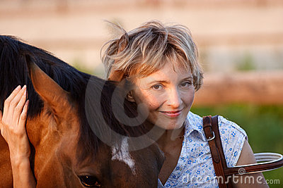 Woman embrace brown horse