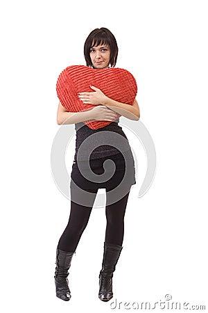 Woman embrace a heart-shape pillow