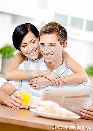 Woman embraces eating boyfriend