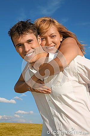 Woman embraces man