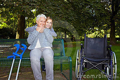 Woman embracing elderly woman oin