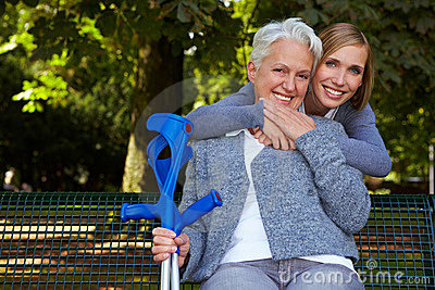 Woman embracing senior