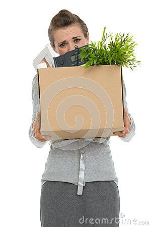 Woman employee hiding behind box with items