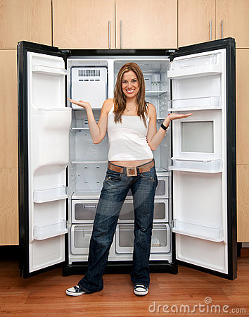 Woman with an empty fridge