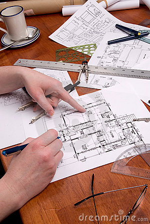 Woman engineer, architect or contractor works on plans