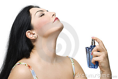 Woman enjoy the fragrance of her perfume