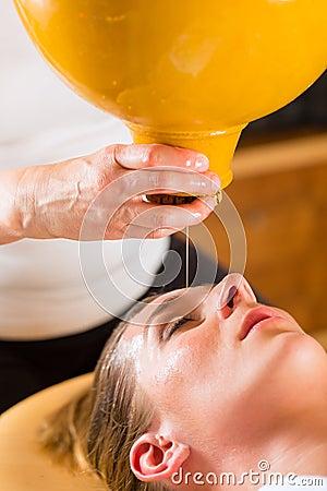 Woman enjoying a Ayurveda oil massage