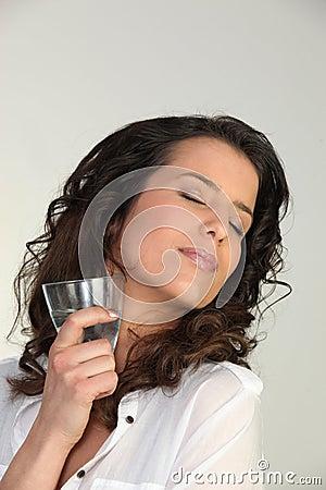 Woman enjoying a cold drink