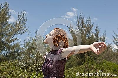 Woman enjoying freedom and nature