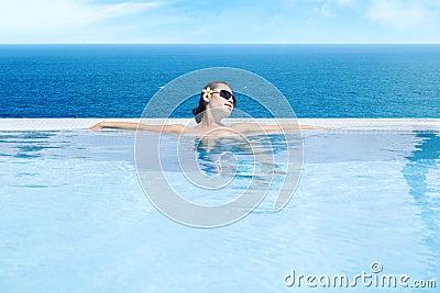 Woman enjoying infinity pool 1