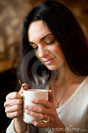 Free Woman Enjoying Latte Coffee In Caf Stock Photo - 7167700