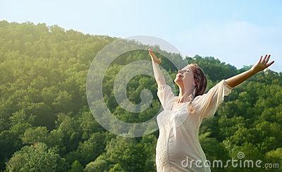 Woman enjoying life outdoors in summer
