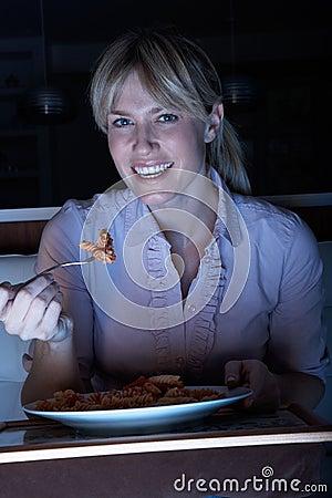 Woman Enjoying Meal Whilst Watching TV