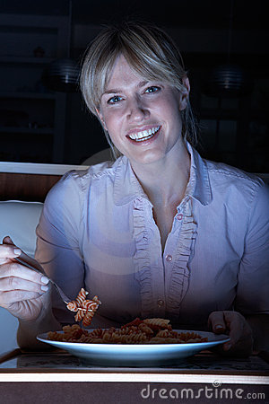 Woman Enjoying Meal Whilst Watching TV