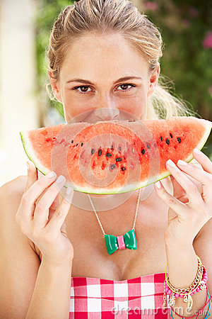 Woman Enjoying Slice Of Water Melon