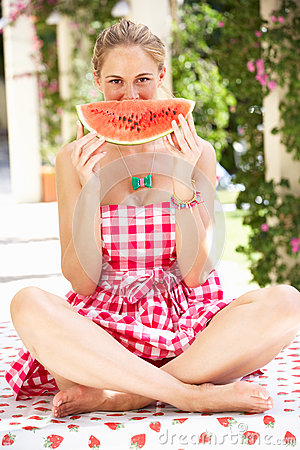 Woman Enjoying Slice Of Water Melon