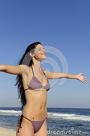 Woman enjoying the sun on the beach
