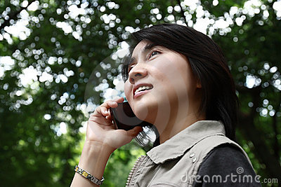 Woman enjoying talking on a cell phone
