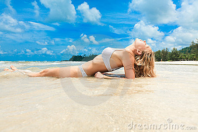Woman enjoying on tropical beach
