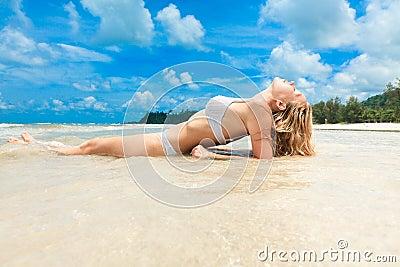 Woman enjoying on tropical beach