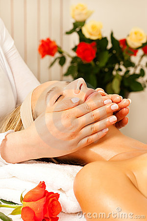 Woman enjoying wellness head massage