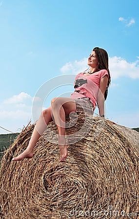 Woman enjoying on the wheat
