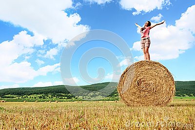Woman enjoying on the wheat