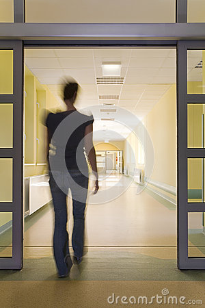 Woman entering a hospital