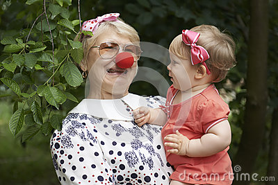 Woman is entertaining her little granddaughter