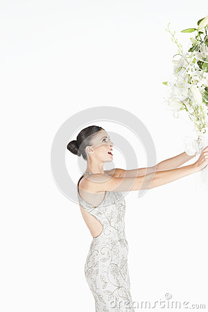 Woman In Evening Dress Accepts Flower Bouquet