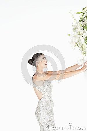 Woman In Evening Dress Accepts Flower Bouquet