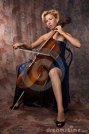 Woman in evening dress playing cello