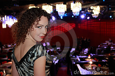 Woman in evening dress at restaurant