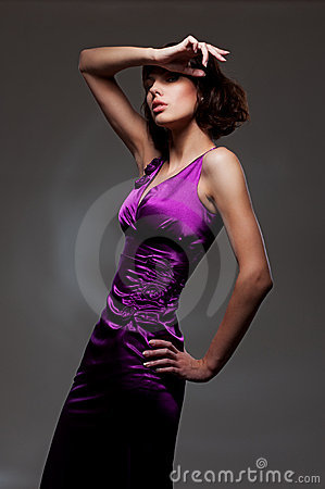 Woman in evening violet dress