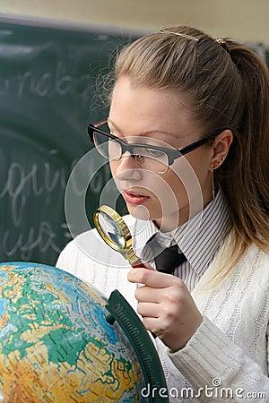 Woman examining a globe