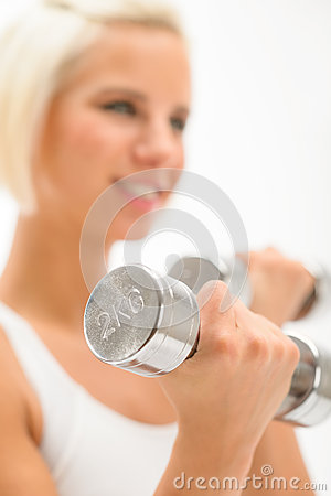 Woman exercise dumbbells white fitness close-up