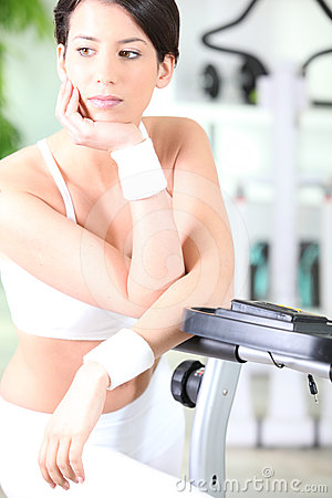 Woman by exercise machine