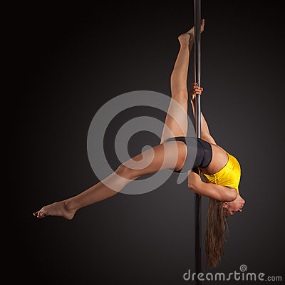 Free Woman Exercise Pole Dance On Gray Background Stock Photography - 59322872