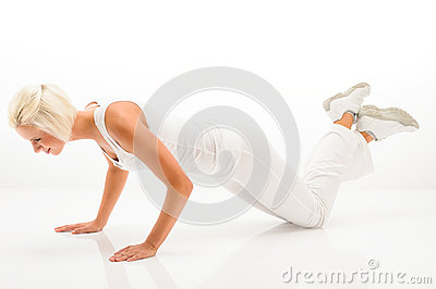 Woman exercise pushup at white fitness outfit