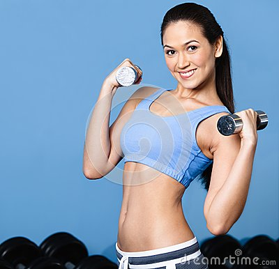 Woman exercises with dumbbells