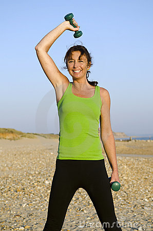 Woman exercising on beach.