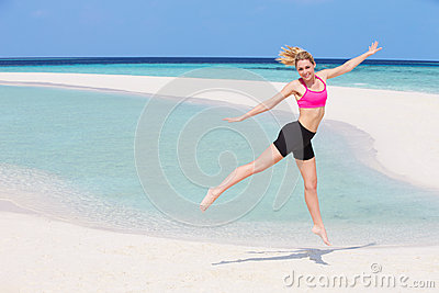 Woman Exercising On Beautiful Beach