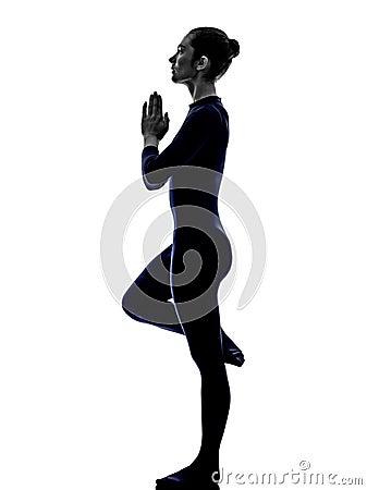 woman exercising bhujangasana cobra pose yoga silhouette