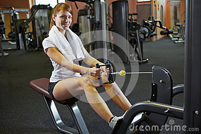 Woman exercising on cable machine