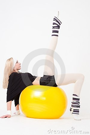 Woman exercising on a fitness ball
