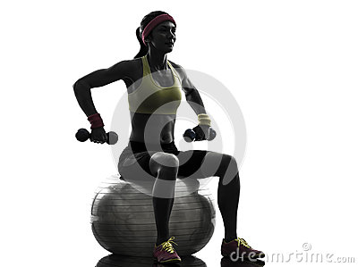 Woman exercising fitness ball weight training  silhouette