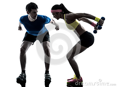 Woman exercising fitness weight training with man coach