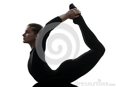 One caucasian woman practicing gymnastic yoga urdhva dhanurasana