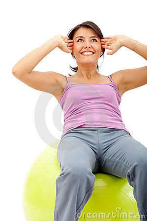 Woman exercising with a pilates ball